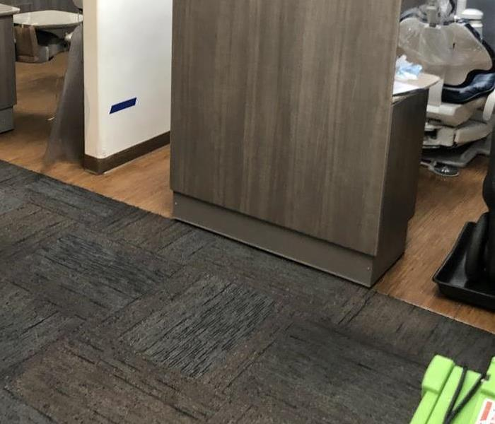 commercial carpeting with water in dental office.