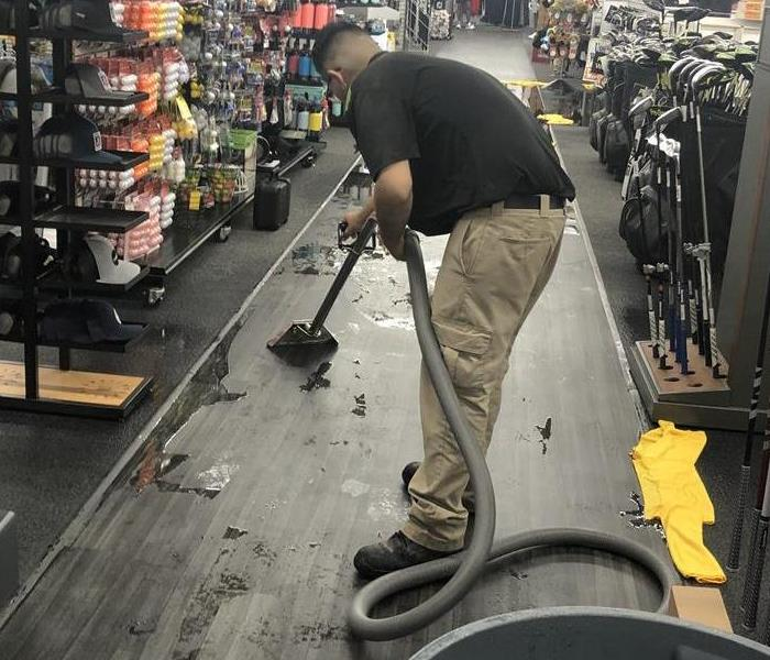 A photo of a  man in a store.